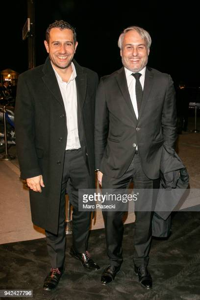 Producers Vivien Aslanian and Romain Le Grand arrive to attend the 'Madame Figaro' dinner at Automobile Club de France on April 5 2018 in Paris France