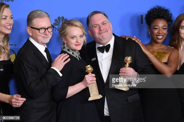 Producers Warren Littlefield Elisabeth Moss Bruce Miller and actor Samira Wiley of 'The Handmaid's Tale' pose with their awards for Best Television...