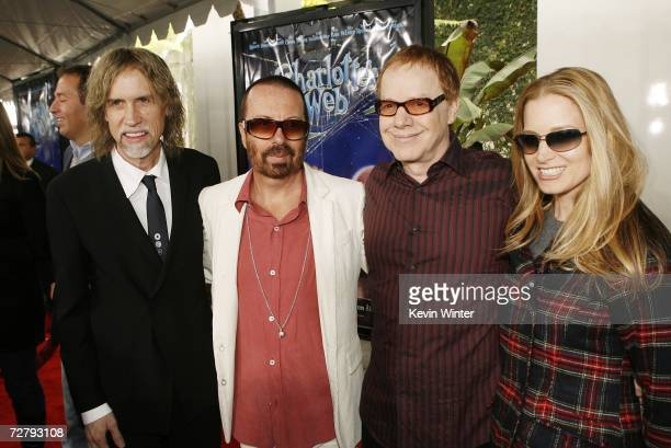 Producer/songwriter Glen Ballard and musicians Dave Stewart Danny Elfman and his wife actress Bridget Fonda pose at the Los Angeles premiere of...