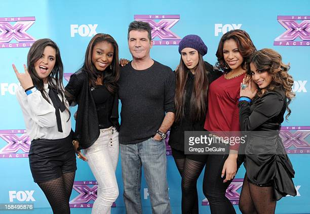 Producer/TV personality Simon Cowell and recording artists Fifth Harmony arrive at 'The X Factor' season finale press conference at CBS Studios on...