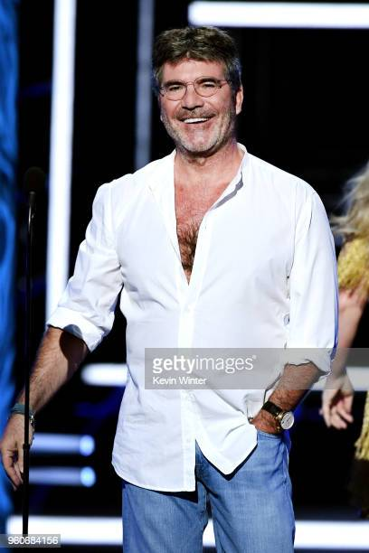 ProducerTV personality Simon Cowell speaks onstage during the 2018 Billboard Music Awards at MGM Grand Garden Arena on May 20 2018 in Las Vegas Nevada