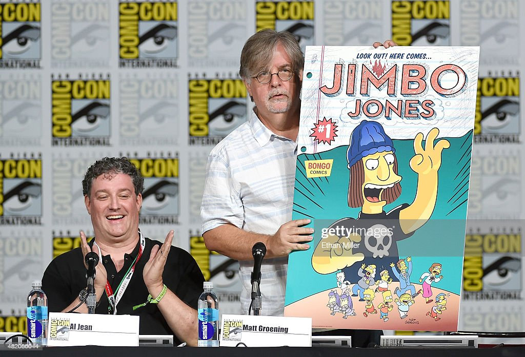 Producer/writer Al Jean (L) looks on as producer/writer Matt Groening unveils the cover of the Jimbo Jones #1 issue of Bongo Comics' Simpsons Comics One-Shot Wonders during 'The Simpsons' panel during Comic-Con International 2015 at the San Diego Convention Center on July 11, 2015 in San Diego, California.