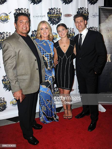 Producer/writer Dimitri Logothetis Janie Des Rosiers and fighter/actor Alain Moussi arrive for the Premiere Of RLJ Entertainment's Kickboxer...