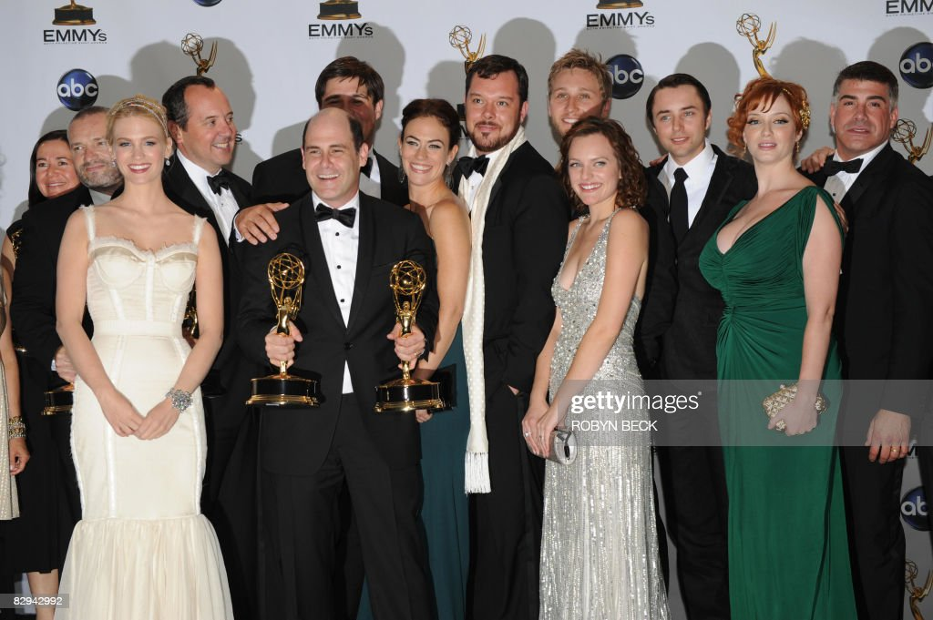 Producer/writer Matthew Weiner (C-L) with the Emmy for Best Drama Series for 'Mad Men', in the press room at the 60th Primetime Emmy Awards at the Noika Theatre in Los Angeles on September 21, 2008. AFP PHOTO Robyn BECK