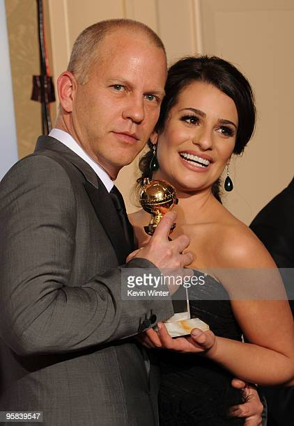 """Producer/writer Ryan Murphy and actress Lea Michele pose in the press room with the award for Best Television Series - Comedy Or Musical for """"Glee""""..."""