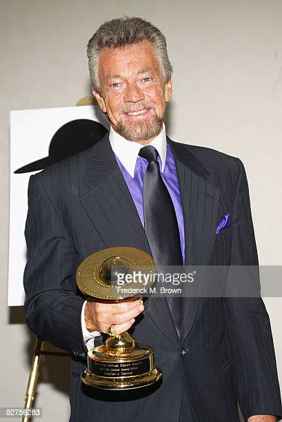 Producer/writer Stephen J Cannell poses with trophy after being honored during the 31st Annual Saturn Awards at the Universal Hilton Hotel on May 3...