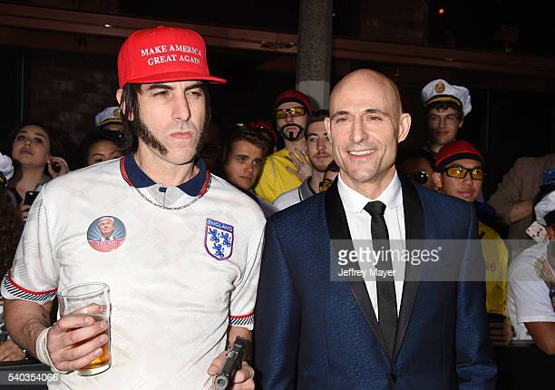 Producer/writer/actor Sacha Baron Cohen and actor Mark Strong arrive at the Premiere Of Columbia Pictures And Village Roadshow Pictures 'The Brothers...