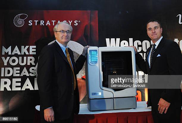 Product Marketing Manager of Stratasys Inc Fred Fischer and Vice President International Sales Woody Frost stand next to the newly launched Uprint 3D...