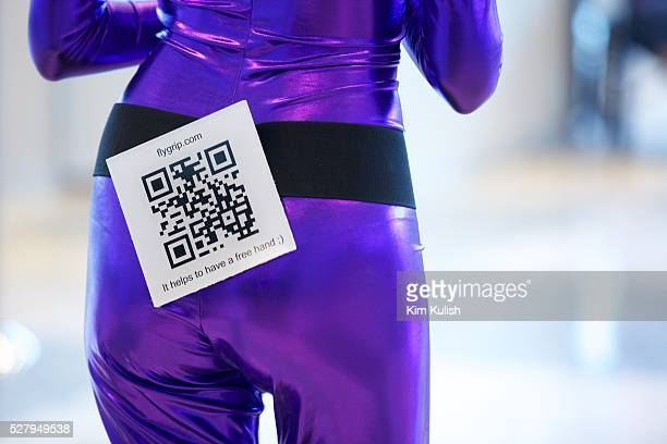 A product model wears a scannable QR code for Flygripcom as Apple enthusiasts attend the opening day of the 2012 Macworld iWorld event in San...