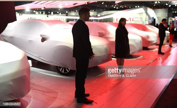 A product specialist stands in the GAC booth at the 2019 North American International Auto Show January 15 2019 at the Cobo Center in Detroit...
