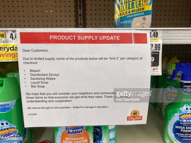 Product supply update sign limiting shoppers to 2 items each of bleach, disinfecting sprays, sanitizing wipes, liquid soap and bar soap on March 13,...