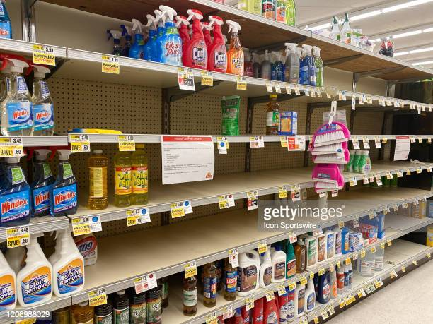 Product supply update sign limiting shoppers to 2 items each of bleach, disinfecting sprays, sanitizing wipes, liquid soap and bar soap and empty...