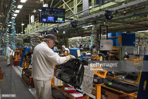 A production associate works on front end modules for 2018 Honda Accord vehicles during production at the Honda of America Manufacturing Inc...