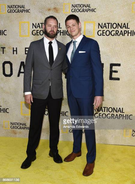 Production consultant Sgt Eric Bourquin and actor Jon Beavers arrive at the premiere of National Geographic's 'The Long Road Home' at Royce Hall on...