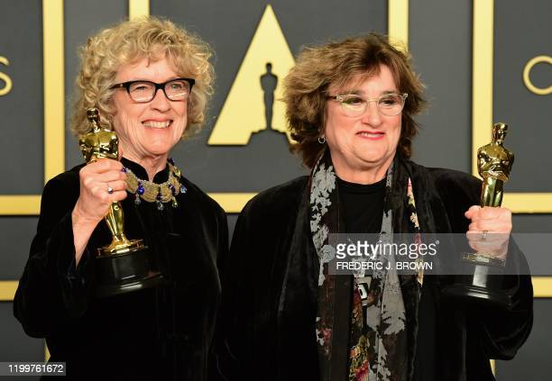 US production designer Barbara Ling and US set decorator Nancy Haigh pose in the press room with the Oscar for Best Production Design for Once upon a...