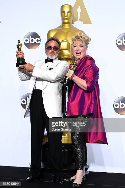 Production designer Colin Gibson and set decorator Lisa Thompson winners of the Best Production Design award for 'Mad Max Fury Road' pose in the...