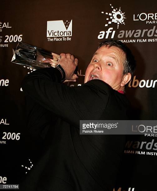 Production Designer David McKay poses in the awards room with the award for Best Production Design at the L'Oreal Paris AFI 2006 Industry Awards at...