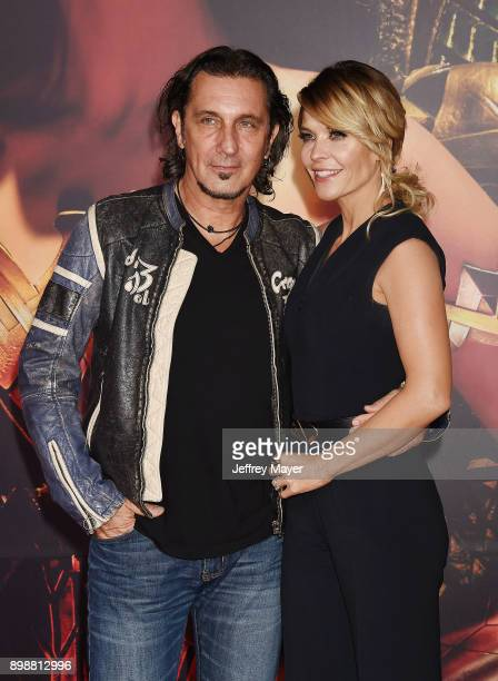 Production designer Patrick Tatopoulos and actress McKenzie WestmoreTatopoulos arrive at the premiere of Warner Bros Pictures' 'Justice League' at...