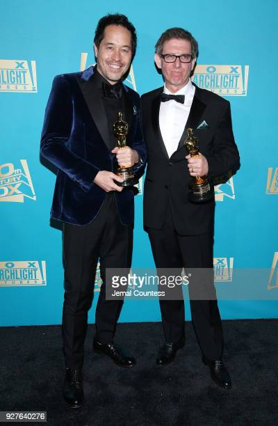 Production designer Paul Austerberry and set designer Jeffrey A Melvin attend the Fox Searchlight And 20th Century Fox Oscars PostParty on March 4...
