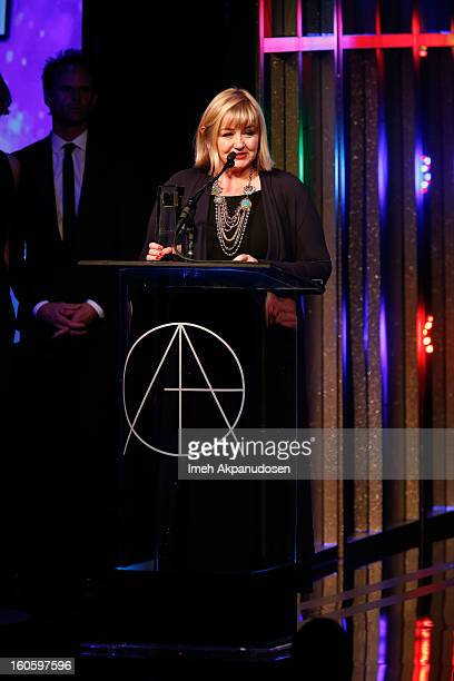 Production Designer Sarah Greenwood accepts the award for Excellence in Production Design for a Period Feature Film 2012 Anna Karenina onstage at the...