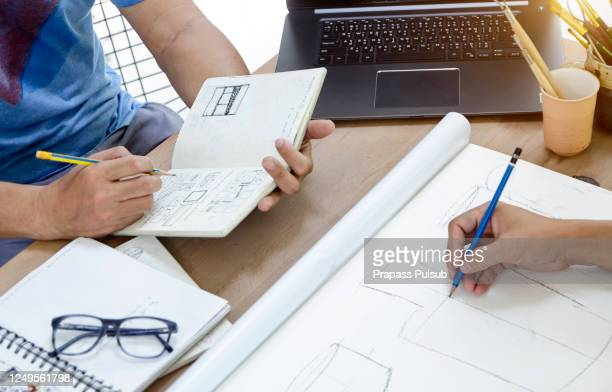 production designer sketching drawing development process prototype design idea creative concept - drawing art product stock pictures, royalty-free photos & images