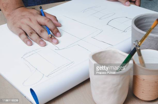 production designer sketching drawing development prototype process design idea creative concept - drawing art product stock pictures, royalty-free photos & images