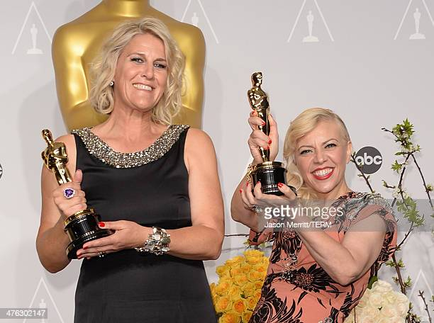 Production designers Beverley Dunn and Catherine Martin winners of Best Achievement in Production Design pose in the press room during the Oscars at...