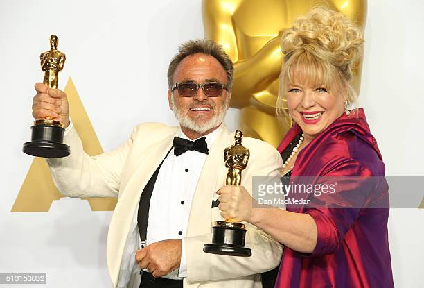 Production designers Colin Gibson and Lisa Thompson winners of the Best Production Design award for 'Mad Max Fury Road' pose in the press room at the...
