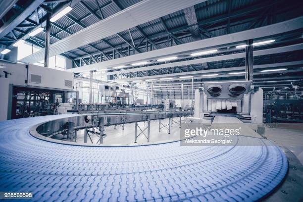 production line and machines in water bottling factory - automation stock pictures, royalty-free photos & images