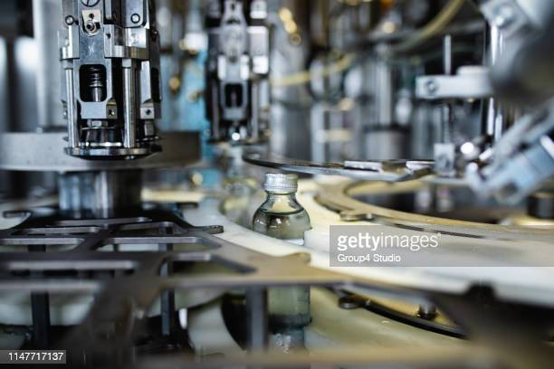 production line for juice bottling - manufacturing equipment stock pictures, royalty-free photos & images