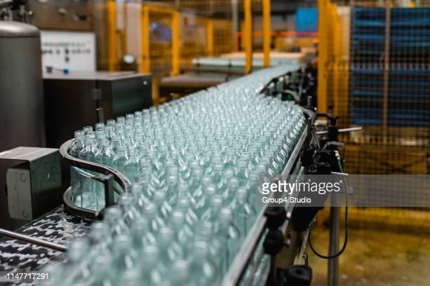 production line for juice bottling - packaging stock pictures, royalty-free photos & images