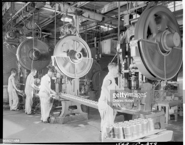 Production line in a brass mill Coffee bowl production line in the brass mill of East Alton Works' ammunition division Location East Alton Illinois...