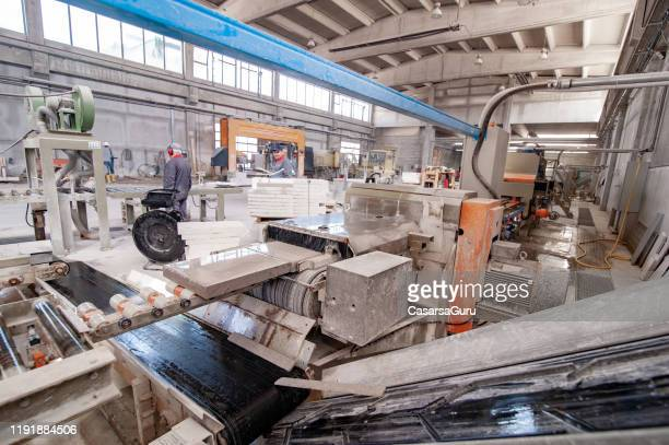production line inside of stone processing factory - stock photo - construction material stock pictures, royalty-free photos & images
