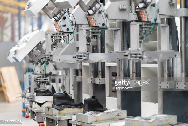 production line of boots at a factory - shoe factory stock pictures, royalty-free photos & images