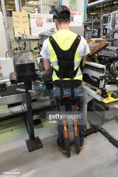 Production line of the Renault plant in Cleon on Worker equipped with an exoskeleton