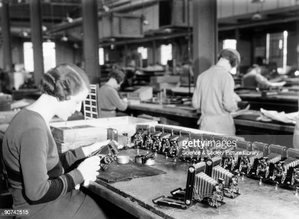 Production line worker assembling a Kodak camera Harrow c 1930s