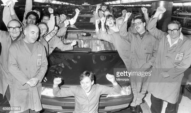 Production line workers at the Peugeot factory at Ryton are seen here celebrating the Car of the year award for the Peugeot 406 which is built at the...