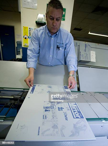 Production manager Graham Moolman lays out a print template of the Daily Mirror at Trinity Mirror's factory in Watford UK on Tuesday April 13 2010...