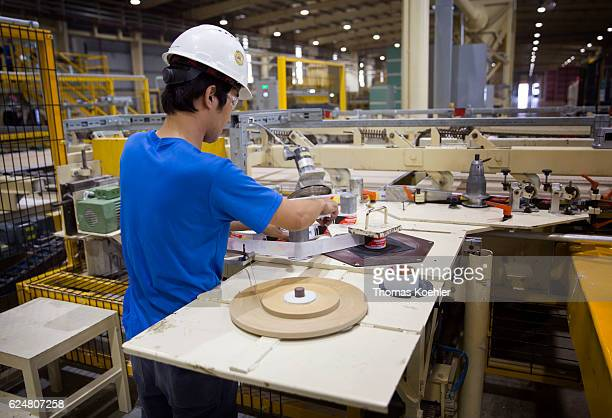 Production of gypsum boards at Knauf Vietnam Ltd An employee sets up a labeling machine on October 30 2016 in Hai Phong Vietnam