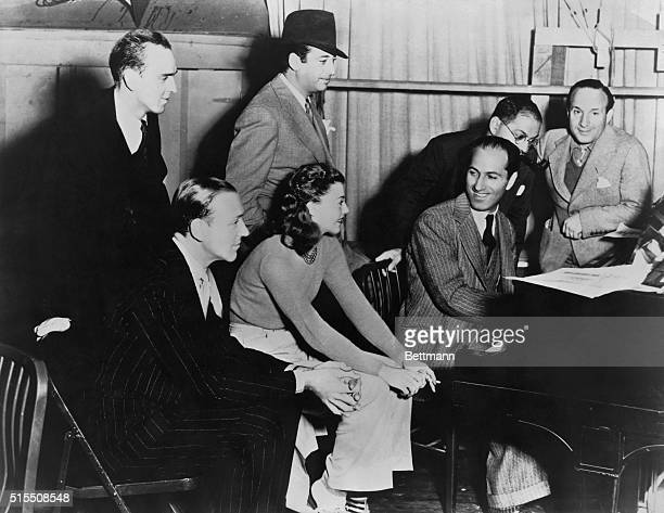 """Production of the film """"Shall We Dance"""" . Standing: Dance director Hermes Pan, director Mark Sanmdrich, Ira Gershwin. Seated: Fred Astaire, Ginger..."""