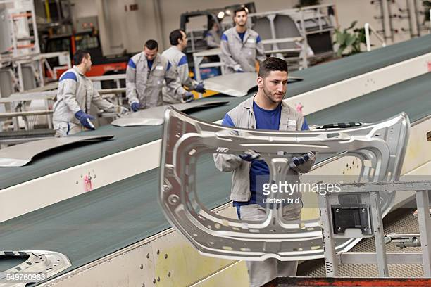 Production of the Golf 7 in Wolfsburg worker with part of a hood Germany Europe