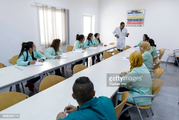 Production of the textile company Sartex A trainer teaches young women and men on January 01 2000 in KSAR HELLAL TUNISIA