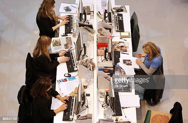 Production staff on the weekly fashion magazine Grazia edit the magazine in a temporary office inside the Westfield shopping centre on November 3...