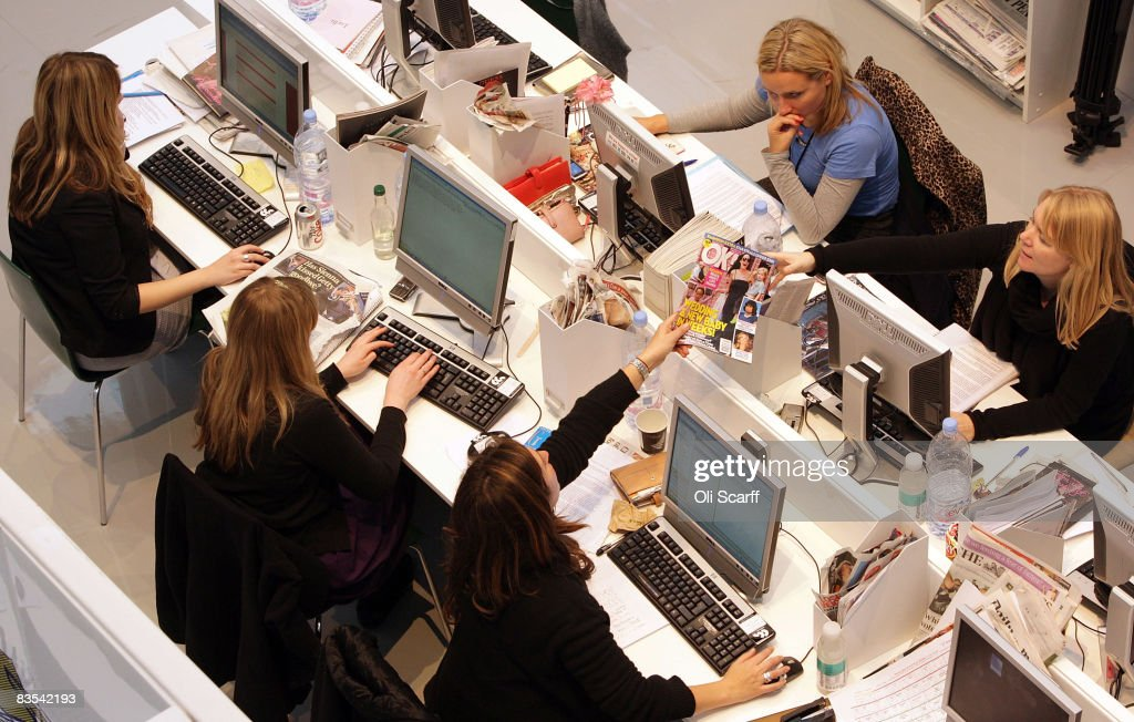 Production staff on the weekly fashion magazine, Grazia edit the magazine in a temporary office inside the Westfield shopping centre on November 3, 2008 in London. For one week Grazia magazine is being produced in the Westfield shopping centre and are offering shoppers free make-overs, fashion consultations and advice on pursuing a modeling career.