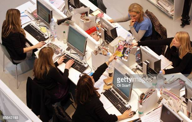 Production staff on the weekly fashion magazine, Grazia edit the magazine in a temporary office inside the Westfield shopping centre on November 3,...