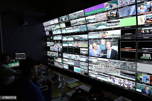 Production staff view screens in an ESPN operation room on day 9 of the Wimbledon Lawn Tennis Championships at the All England Lawn Tennis and...