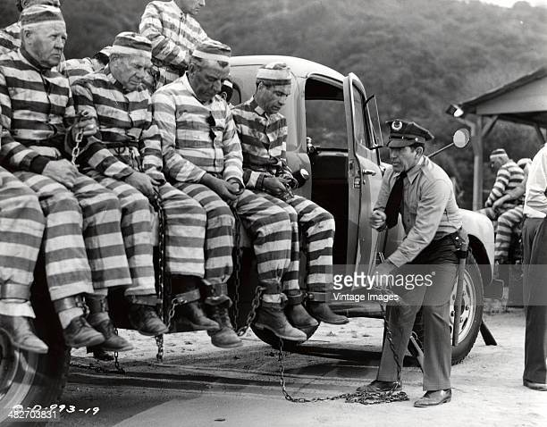 A production still from the Columbia Pictures Corporation film 'Chain Gang' showing a group of convicts on a truck 1950 Photo by stills photographer...