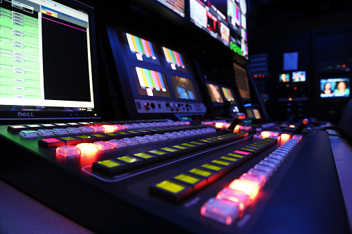 TV Production Switcher in Control Room 487606727