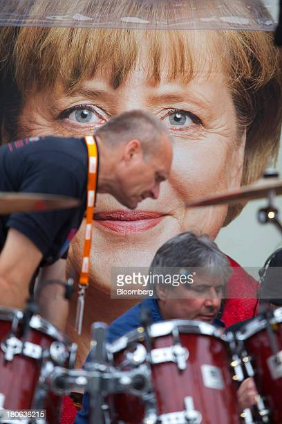 Production technicians prepare a stage for a band to perform before Angela Merkel Germany's chancellor and party leader of the Christian Democratic...