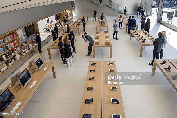 Products are displayed as attendees view the new Apple Inc flagship store at Union Square in San Francisco California US on Thursday May 19 2016 The...